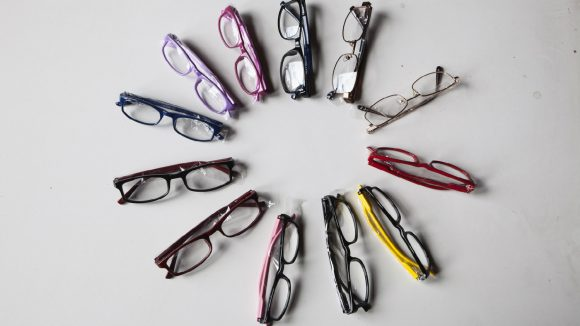 A selection of brightly coloured glasses for children.