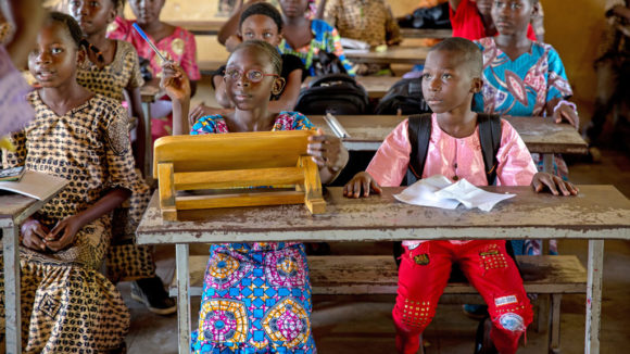 School children sit at desks at an inclusive school in Mali.